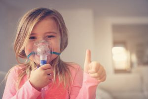 little girl with oxygen mask