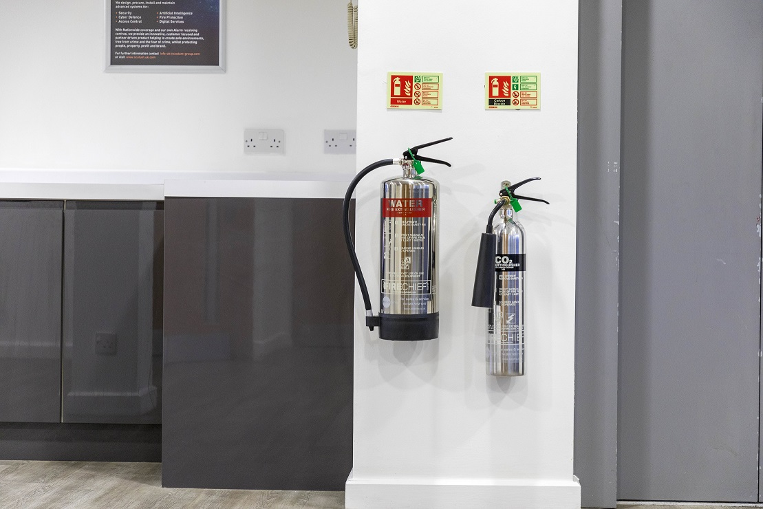 fire extinguishers on a wall